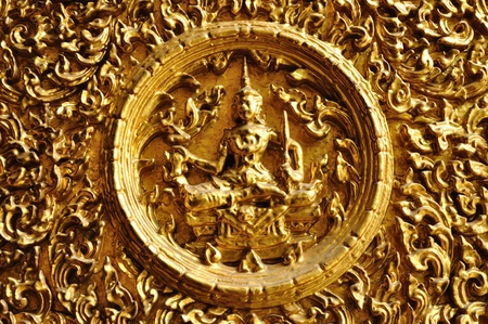 The Ancient sign made of carved wood.  It is ancient Thai art. photo