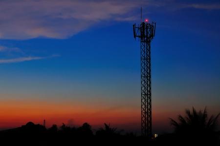 Cellular tower at sunset in Thailand, Bangkok. photo