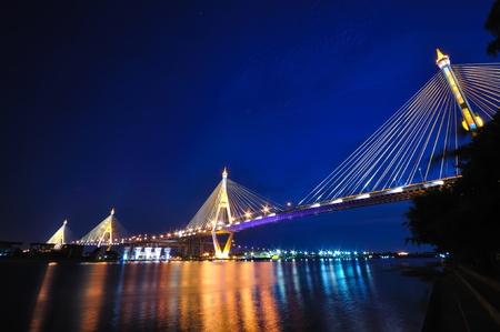 changed: Industrial circle bridge at night in Bangkok, Thailand.  Present, name was changed to King Bhumibhol bridge. Stock Photo