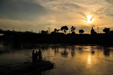 Sunset beside river in Pitsanulok, Thailand. photo