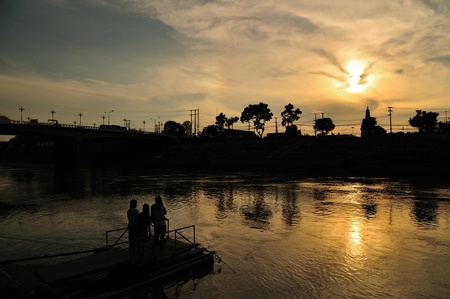 Sunset beside river in Pitsanulok, Thailand. Stock Photo - 9749884