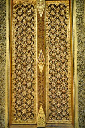 Thai art golden carving wooden door photo