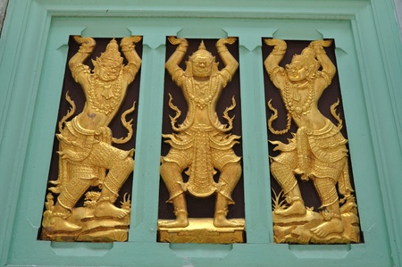 Thai art on carving wooden window Stock Photo - 9969512
