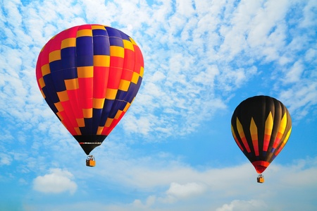 hot air balloon with beautiful blue sky and nice cloud in Thailand. photo