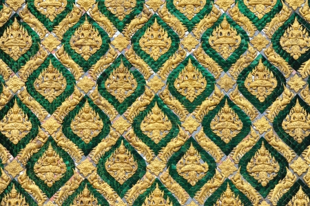 Pattern of traditional Thai art decorated on mirror tile in Royal palace, Bangkok, Thailand.