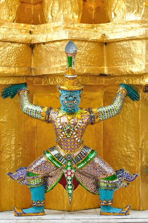 Antique Thai doll of Giant decorate around golden pagoda in Thai temple in Royal palace. photo