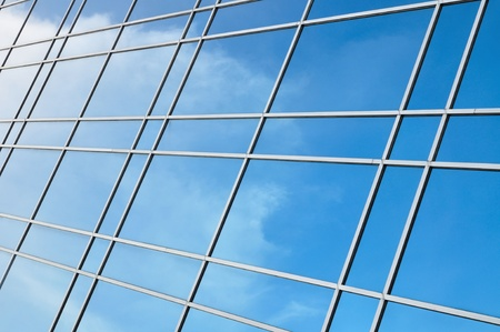 reflection of cloud and sky on building glass as background  photo