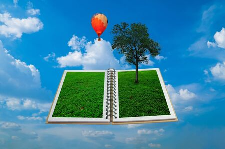 Open book with tree and hot air balloon  photo