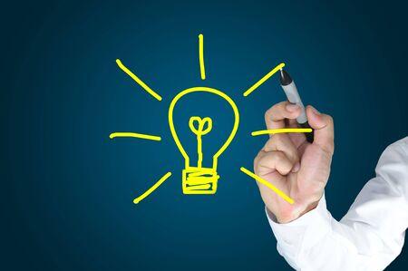 Hand of business man write light bulb photo