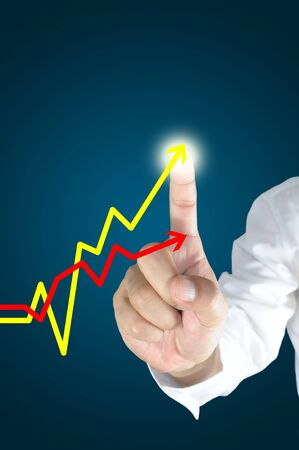 economic growth: Hand of business man touch the line graph