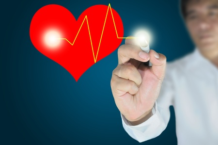 business man write or draw heart and heart pulse photo