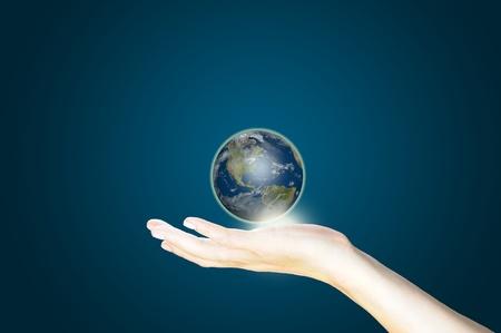 earth globe in hand photo
