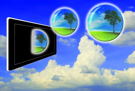 Crystal ball with lonely tree fly from touch pad or tablet photo