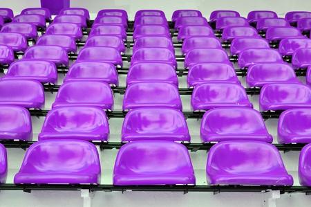 Red seat in sport stadium, Bangkok, Thailand. photo