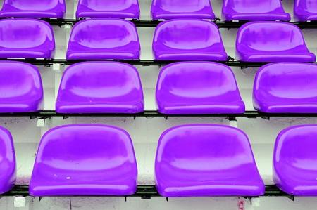 Red seat at Thep Hasadin Stadium in Bangkok, Thailand photo