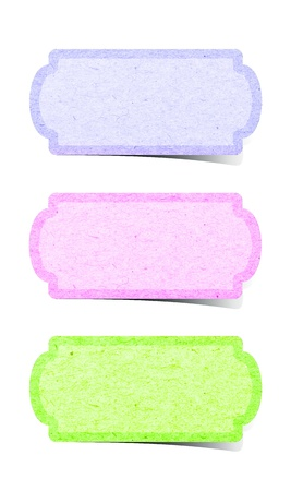 Recycle paper tag stick on white background  photo