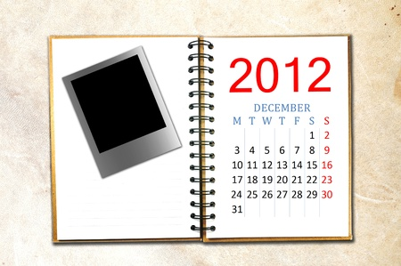 open note book with calendar 2012. Month is December. photo