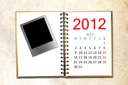 open note book with calendar 2012. Month is July. photo