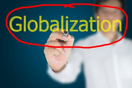Business man write Globalization on touch screen photo