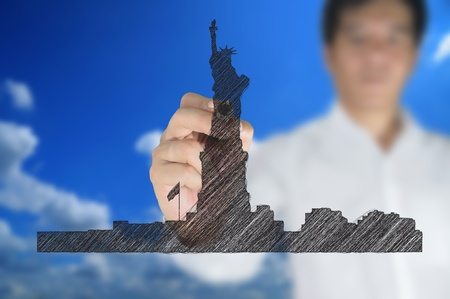 asian man teacher drawing statue of liberty photo