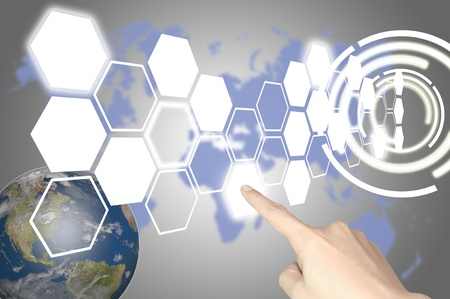technology metaphor: Hand of business man press hexagon button on world map or tablet pc touch screen Stock Photo