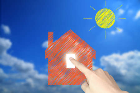 Hand of business man write a house and sun Stock Photo - 11183986