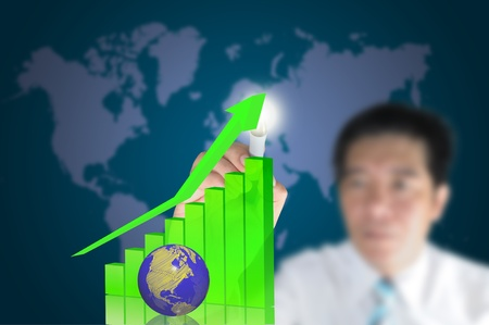 Hand of business man write 3d graph with earth globe photo