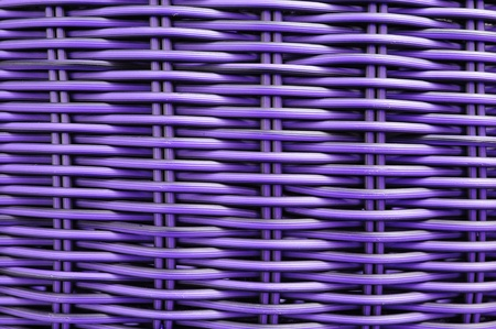 cane chair: Simulated plastic rattan weaving or artificial texture (furniture). Color is purple