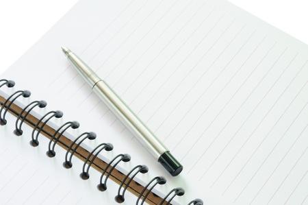 calendario escolar: Cuaderno y bolígrafo en el concepto de negocio o de la educación Foto de archivo
