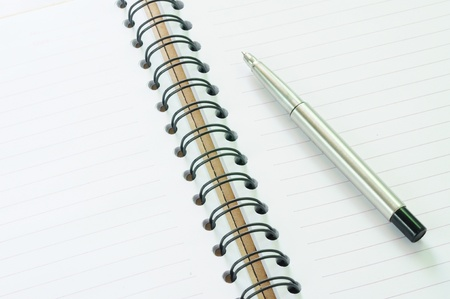 Notebook and pen in concept of business or education photo