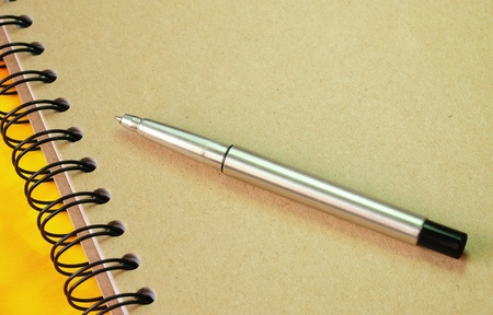 Ring binder book and ball pen photo