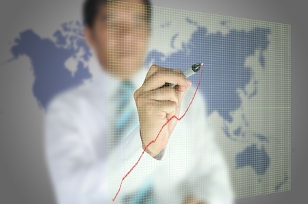 Business man write graph on touch screen display photo