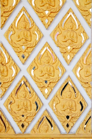 Thai style molding art on wall of Wat Phra That Harinpoonchai temple in Lampoon, Thailand