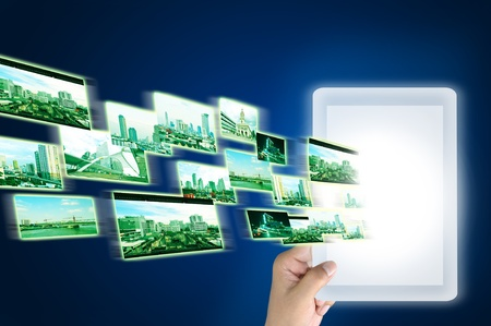 Flying images run through the tablet pc as wireless communication concept Stock Photo - 11617732