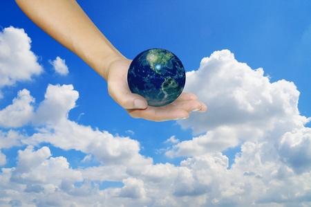 Earth globe in male hand photo