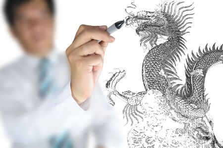 Business man draw chinese dragon  photo