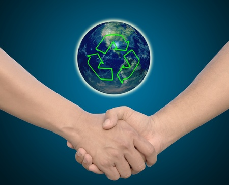 hand in Hand or handshake and earth globe and recycle symbol photo