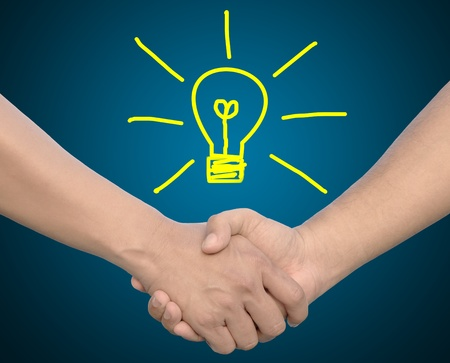 technology deal: hand in Hand or handshake and light bulb