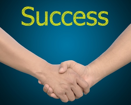 combined effort: hand in Hand or handshake with the word Success Stock Photo