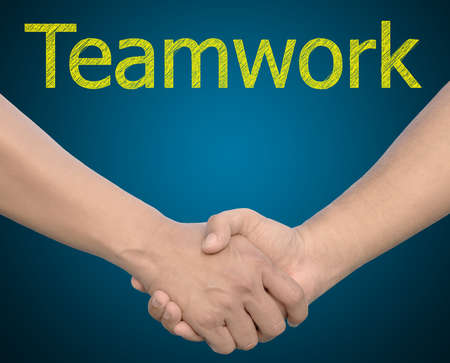 hand in Hand or handshake with the word Teamwork Stock Photo - 11858316