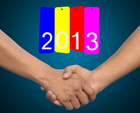 hand in Hand or handshake and happy new year 2013 photo