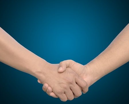 hand in Hand or handshake on blue background photo