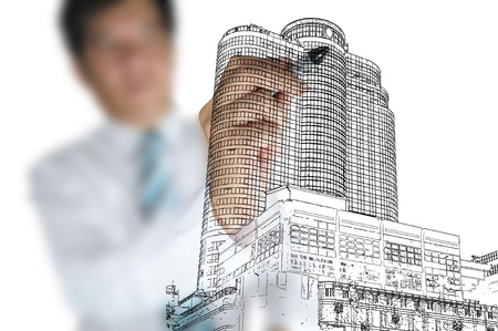Hand of Business man draw modern building Stock Photo