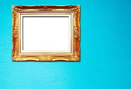 Blank golden frame on blue cement wall photo
