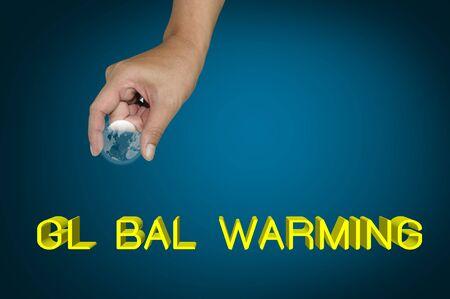 Hand pick earth globe as O on the word Global warming Stock Photo - 12004355