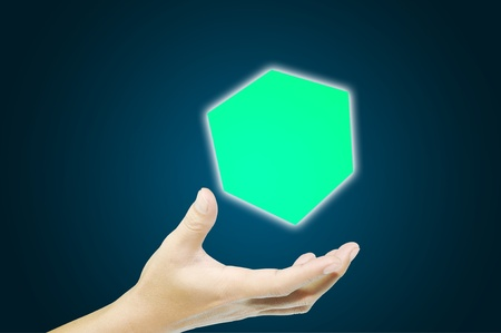 Business man hand holding cubic photo