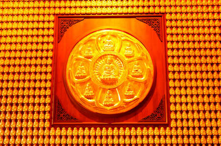 Flower wheel of buddha over pattern of golden wood carving buddha on chinese temple wall photo