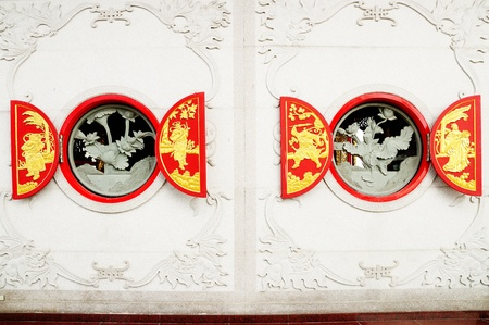 Double opend red wood window decorated with chinese style carving. photo