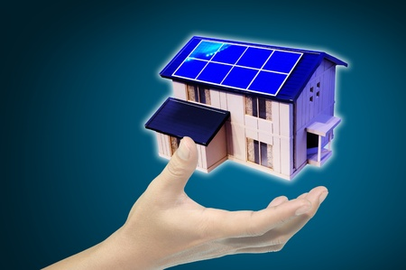 hand hold solar power house or home Stock Photo - 12088368