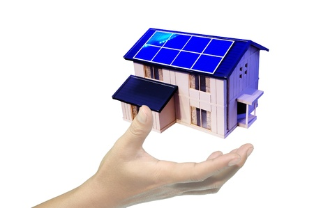 hand hold solar powered house or home Stock Photo - 12088347